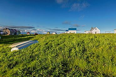 Old boat and summer houses, Flatey Island, Borgarfjordur, Iceland.
