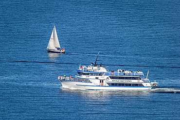 Tourist on Whale Watching boat and small sailboat, summertime, Reykjavik, Iceland.