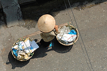Woman Carriying Baskets In Hanoi, Vietnam