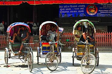 Three rickshaws with their drivers, Durbar Square, Kathmandu, Nepal
