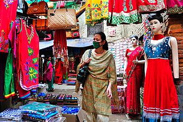 Woman shopping at a fabric store, Indra Chowk market, Kathmandu, Nepal