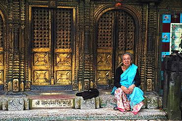 Woman at Changunarayan Hindu temple, Kathmandu Valley, Nepal