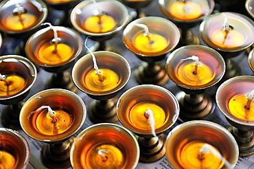 Candles offerings, Tibetan Buddhist monastery of Tashiling, Pokhara, Nepal