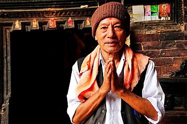Greeting ritual of a Buddhist man, Bhaktapur, Nepal