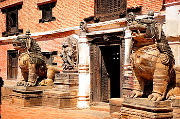 Lions in stone at entrance of National Art Gallery, Durbar Square, Bhaktapur, Nepal.