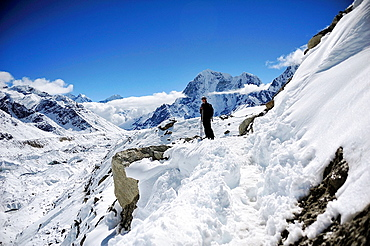 Hiker on Khumbu Glacier, Sagarmatha National Park, the Himalaya range, Khumbu area, Solukhumbu District, Sagarmatha Zone, Nepal