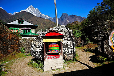 Mani stone and prayer wheel, Sagarmatha National Park, the Himalaya range, Khumbu area, Solukhumbu District, Sagarmatha Zone, Nepal.