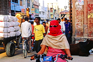 Young girl protecting her face of sunlight, Bikaner, Rajasthan state, India