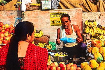 Woman shopping fruit at market, Bikaner, Rajasthan state, India