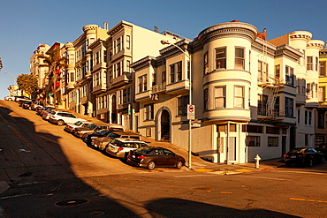 Victorian houses Illuminated by the warm afternoon sun on the corner of Kearny and Green Street,Telegraph Hill,San Francisco,California.