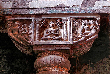 Cave 19: Mid Shot of pillar capital detail, showing Buddha seated in Padmasana. Ajanta Caves, Aurangabad, Maharashtra, India.