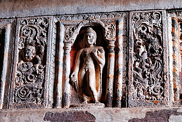 Cave 19 : Interior. Architrave showing one of the standing Buddha image in Varada mudra. Ajanta Caves, Aurangabad, Maharashtra, India.