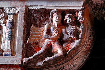Cave 19 : Pillar capital detail. Flying figures on one side of the capital. Ajanta Caves, Aurangabad, Maharashtra, India.