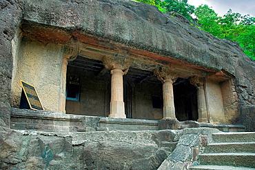 Cave 20: Facade. Pillars capitals are exquisitely carved and bears female brackets. Ajanta Caves, Aurangabad, Maharashtra, India.