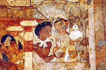 Cave 2: Nurse and attendant one holding a globular jar close to a banana tree. Ajanta Caves, Aurangabad, Maharashtra, India.