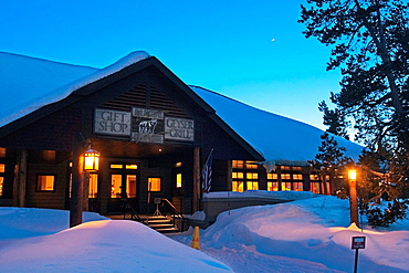 Night shot exterior of Snow Lodge at Yellowstone National Park at Old Faithful Geyser Basin, Wyoming, USA.