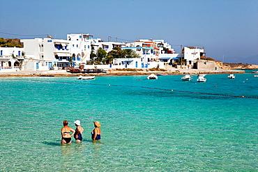 Elderly women in swimsuit taking their time in the sea, Koufonissi, Cyclades Islands, Greek Islands, Greece, Europe.