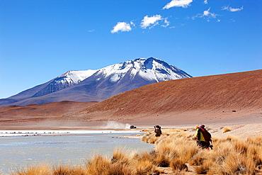Visitors at Laguna Verde, Salar de Uyuni, Salt Desert, Bolivia, South America.