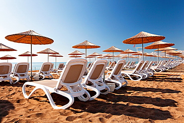 Parasols and sunbeds at the beach, Belek, Antalya, Turkey, Europe.