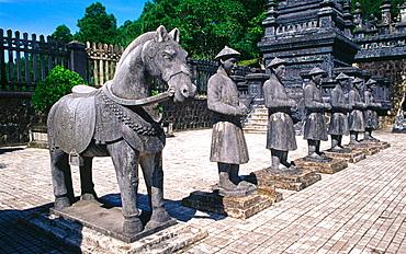 Statuary of mandarins outside the tomb of Khai Dinh, emperor of Vietnam (1916-25), near Hue, Vietnam
