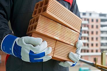 Worker picking bricks, Housing construction, apartments, San Sebastian, Gipuzkoa, Euskadi, Spain.