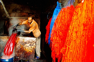 Man working in the dyer's souk, Marrakech, Morocco