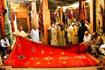 Carpets auction in souk, Marrakesh, Morocco