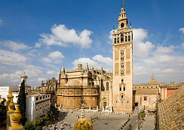 Seville Spain La Giralda tower and cathedral seen across Plaza Virgen de los Reyes