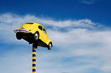 Yellow flying beetle, car statue in industry park of Dunedin, Otago, East Coast, South Island, New Zealand