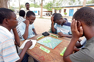 Boys playing scrabble at recreation Center, Musoma, Tanzania