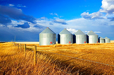 Grain silos, landscape with dramatic sky, Stand Off, Alberta, Canada