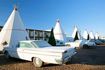 Wigwam motel concrete teepees and 1960 Pontiac on Route 66 in frosty morning, Holbrook, Arizona, USA
