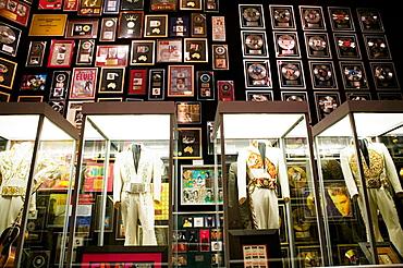 Elvis Presley's  Las Vegas Costumes & gold records, Former Residence of Elvis Presley, Graceland, Memphis, Tennessee, USA