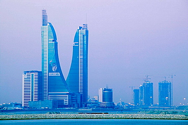 BAHRAIN-Manama: Bahrain Financial Harbor from Muharraq Island / Dawn