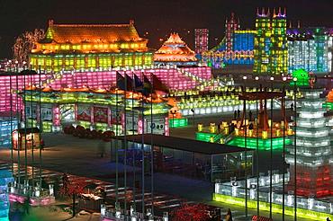 China, Heilongjiang, HAERBIN (Harbin): Haerbin Ice and Snow World Festival, All Buildings built of ice, Evening Overview of the Ice Festival