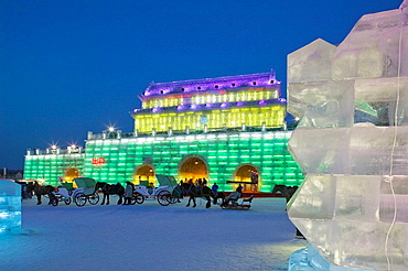 China, Heilongjiang, HAERBIN (Harbin): Haerbin Ice and Snow World Festival, All Buildings built of ice, Entrance Gate and Horse Drawn Carriages