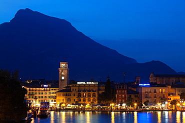 Italy, Trentino-Alto Adige, Lake District, Lake Garda, Riva del Garda, town view with Torre Apponale, 13th century tower, evening