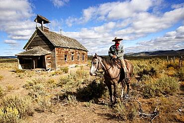 Cowboy and old 1900s school, Ponderosa Ranch, Seneca, Oregon , USA