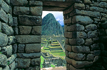 Ruins viewed through a doorway, Machu Picchu, Peru