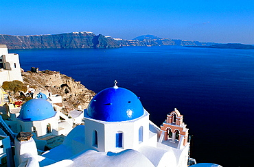 Greece, Cyclades Islands, Santorini, Oia village, White Churches with blue dome in front of the sea.