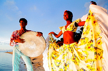 Playing and dancing 'souk' music on the beach, Mauritius Island