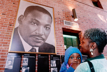 Grandmother with kid looking at Martin Luther King's portrait, in the Martin Luther King Foundation for Peace, Atlanta, Georgia, USA