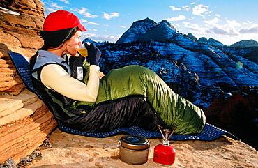 Woman waking up with sunrise at Zion National Park, Utah, USA