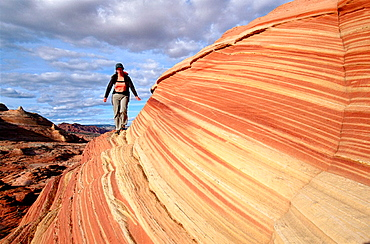 "Hiking, ""The Wave"", Coyote Buttes, Paria wilderness, Arizona, USA."