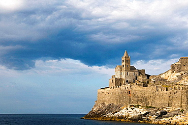 Italy, Linguria, Porto Venere, Church building atop defensive walls at the headlands, Seaside town on the Italian Riviera, south of Cinque Terre National Park.