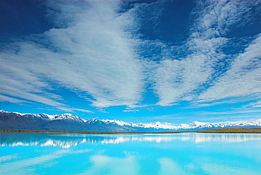 Tekapo Canal (hydro scheme), looking towards Mt Cook with lenticular north-west cloud patterns, New Zealand