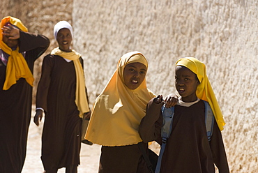 Girls stepping out of school in Harar, Ethiopia, Africa