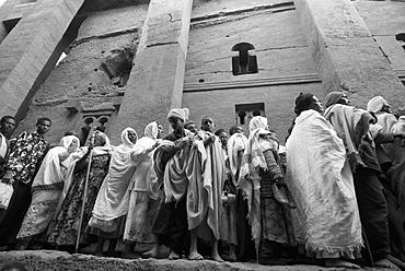 Pilgrims in front of Beth Medhane Alem monolithic church, Lalibela, Ethiopia, Africa
