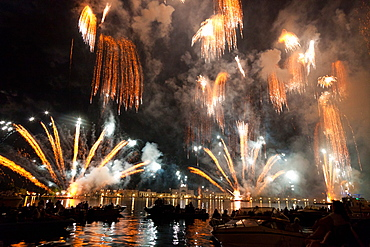 The amazing fireworks display during the night of Redentore celebration in the basin of St. Mark, Venice, Veneto, Italy, Europe