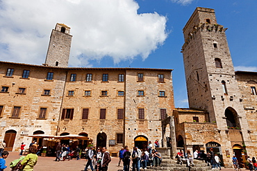 Buildings and towers overlooking Piazza della Cisterna, San Gimignano, UNESCO World Heritage Site, Siena, Tuscany, Italy, Europe